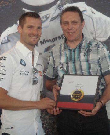 Rennfahrer Martin Tomczyk mit Heinrich Kürzeder